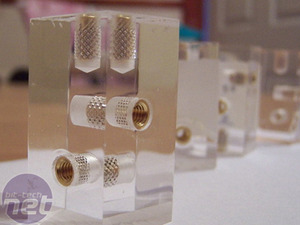 Phinix Cube used acrylic cubes, with screw holes that were lined with brass inserts.